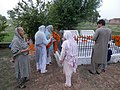 Remembering the dead, Pakistani women at the graves.jpg