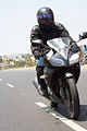 Rider in motion on Yamaha YZF-R15 front.jpg