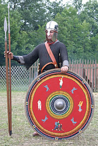 A re-enactor, portraying a legionary at the end of the 3rd century Roman soldier end of third century northern province - cropped.jpg