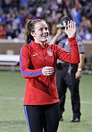 U.S. player Rose Lavelle waving to a member of the audience
