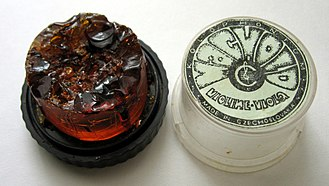 Rosin - A cake of rosin, made for use by violinists, used here for soldering