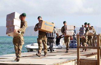 Effects of Hurricane Irma in the British Virgin Islands - Royal Marines delivering aid on Jost Van Dyke.
