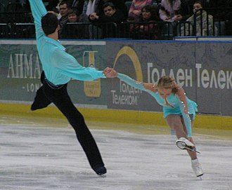 Death spiral (figure skating) - Woman in shoot-the-duck position during entry to back inside death spiral