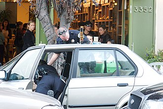 Motor vehicle exception - San Francisco Police searching a vehicle after a stop in 2008.