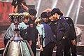 SK Telecom T1 huddle near 2015 League of Legends World Champtionship trophy.jpg
