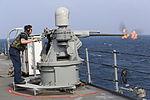 Sailor fires Mk 38 gun on USS Blue Ridge (LCC-19) in 2014.JPG