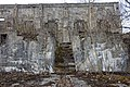 Salangsverket Reinforced concrete ruins of iron ore mining industrial plant (jernbrikettstøperi havn etc) 1907–1912 Langneset Salangen Troms Northern Norway Spring naked trees buds etc 09369.jpg
