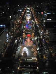Sapporo Snow Festival Odori-Site At Night Panorama 1.jpg