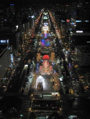Sapporo Snow Festival - Image: Sapporo Snow Festival Odori Site At Night Panorama 1