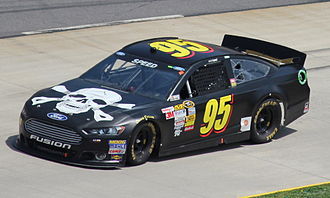 Scott Speed - Speed competing in the 2013 STP Gas Booster 500.