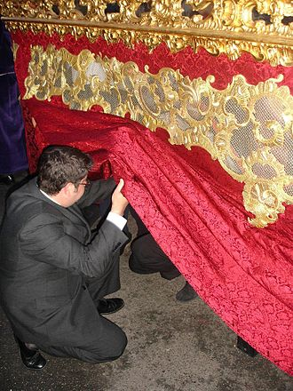 Holy Week in Seville - Overseer giving orders to the costaleros.