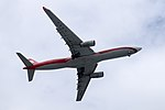 Shanghai Airlines Airbus A330-343X B-6097 on Final Approach at Taipei Songshan Airport 20150201.jpg