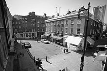 Black and white view of Shepherd Market, London, from an upper storey window