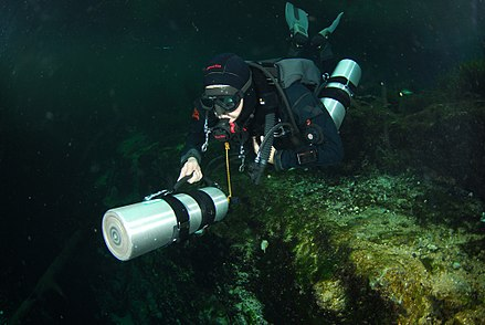Sidemount diver pushing a cylinder in front Sidemount 032 Photo by Pete Nawrocky.jpg