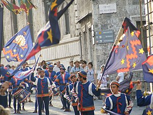 Contrade of Siena - Parade of Nicchio contrada through the old city of Siena