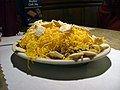 "A ""4-way Cincinnati chili"" is spaghetti topped with a Greek-inspired meat sauce, chopped onions, and shredded cheddar."