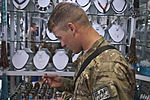 Soldiers look for perfect holiday gift at Bagram bazaar DVIDS350681.jpg