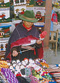 Spinning woman in Ecuador on a market.jpg