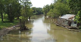 St. Francis River - The St. Francis River at Lake City, Arkansas is placid and silt-laden.
