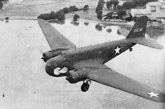Douglas B-18 Bolo - A B-18 operated by Australian National Airways on behalf of the USAAF, flying over the Brisbane River in 1943