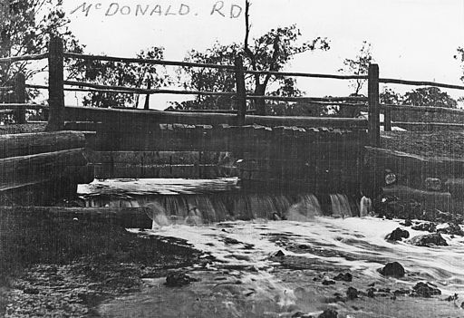 StateLibQld 1 68755 Bridge and weir at McDonald Road, Windsor, ca. 1910