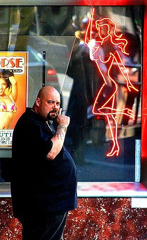 Bouncer (doorman) - A bouncer in front of a strip club in San Francisco, California