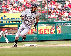 Base running - Ichiro Suzuki rounds third base to run towards home plate