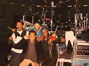 Toots Hibbert - Members from Toots & the Maytals and Dave Matthews Band when performing together in 1998. Paul Douglas (left), Carter Beauford (back), LeRoi Moore (front), Toots Hibbert (right).