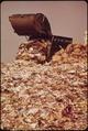 TRUCK PILING GARBAGE IN HACKENSACK MEADOWS DUMP BEHIND FT LEE. THE DUMP SERVES 250,000 BERGEN COUNTY RESIDENTS. IT... - NARA - 549746.tif