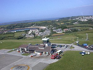 St Mary's Airport, Isles of Scilly - The airport building (before the recent redevelopment); Old Town is seen just beyond the airport.