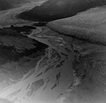 Taku and Norris Glaciers, terminus of tidewater and valley glaciers and braided streams between the two, September 15, 1972 (GLACIERS 6212).jpg