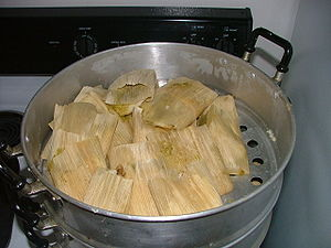 A batch of typical Mexican tamales in the tamalera
