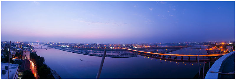 Panorama of Tapi river in Surat city at dusk with partial daylight and lights illuminated