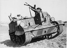 An open-topped military vehicle containing soldiers, who point a mortar and a machine gun upwards.