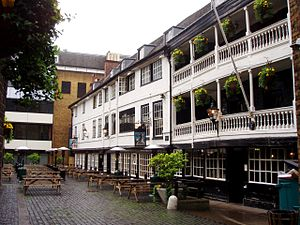 Inn-yard theatre - The George Inn, Southwark, a surviving galleried inn. Although the inn was established in the medieval period, the building was rebuilt after a fire in 1676.