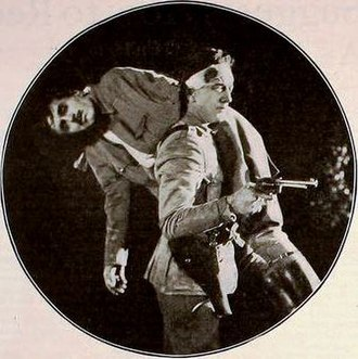 Frank Elliott (actor) - Frank Elliott being carried by Jack Mulhall in The Hope (1920)