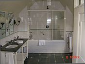 bathroom with two sinks and a bath tub in a hotel