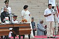 The President, Shri Pranab Mukherjee administering the oath as Cabinet Minister to Shri D.V. Sadananda Gowda, at a Swearing-in Ceremony, at Rashtrapati Bhavan, in New Delhi on May 26, 2014.jpg