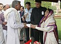 """The President, Smt. Pratibha Devisingh Patil receiving greetings from all walks of life and distributing sweets, on the occasion of """"Diwali"""", at Rashtrapati Bhavan, in New Delhi on November 05, 2010.jpg"""