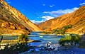 The blue river between the golden mountain in Gilgit-Baltistan.jpg
