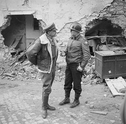 General Sir Harold R. L. G. Alexander, Commander-in-Chief (C-in-C) of the Allied Armies in Italy (AAI), with Major General Lucian K. Truscott Jr., commander of the U.S. VI Corps, in the Anzio beachhead, Italy, 4 March 1944. The commander of the Allied Armies in Italy, General Sir Harold Alexander, with American General Truscott, in charge of the Allied bridgehead at Anzio, 4 March 1944. NA12364.jpg