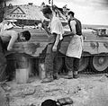 The crew of a Crusader tank have a wash and shave by the side of their vehicle, North Africa, March 1942. E9785.jpg