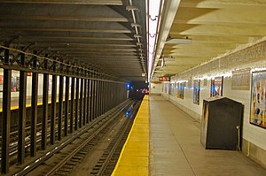 Third Avenue (BMT Canarsie Line) - Third Avenue station with an L train receding down the line