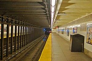 Third Avenue (BMT Canarsie Line) - Third Avenue station with an L train receding down the line