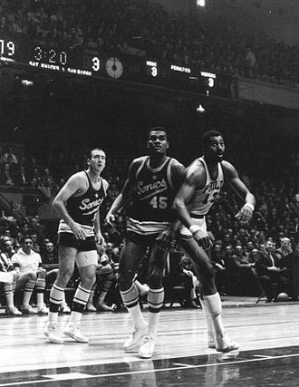 Bob Rule - Tom Meschery (left), Bob Rule (center) and Wilt Chamberlain (right)
