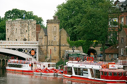 Tour boats offer visitors a glimpse of the city from another perspective Tour boats on the River Ouse.jpg