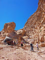 Tourists and Bedouin tent shop on trail to Ad-Deir, Petra, Jordan.jpg
