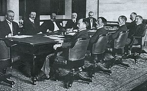 Komura Jutarō - Negotiating the Treaty of Portsmouth (1905) – from left to right: the Russians at far side of table are Korostovetz, Nabokov, Witte, Rosen, Plancon; and the Japanese at near side of table are Adachi, Ochiai, Komura, Takahira, Sato.  The large conference table is today preserved at the Museum Meiji Mura in Inuyama, Aichi Prefecture, Japan.