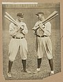 Ty Cobb, Detroit, and Joe Jackson, Cleveland, standing alongside each other, each holding bats LCCN89714223.jpg
