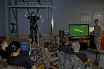 U.S. Air Force Staff Sgt. Robert Colliton, 18th Operations Support Squadron survival, evasion, resistance and escape specialist, gives each Civil Air Patrol cadet a chance to use the parachute simulator.jpg